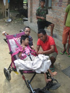 A girl with cerebral palsy that we supplied a wheelchair to