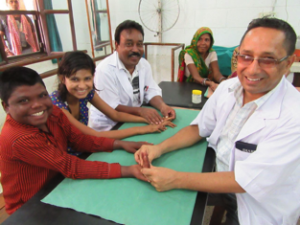 Vibya and Punwashi having daily hand physiotherapy